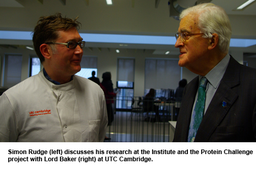 Simon Rudge discusses his research at the Institute and the Protein Challenge project with Lord Baker.
